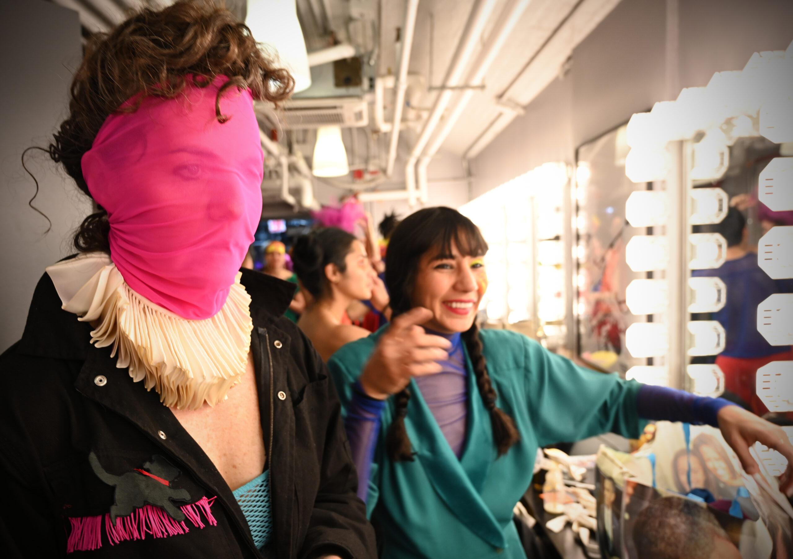 Savitri D in pink face mask