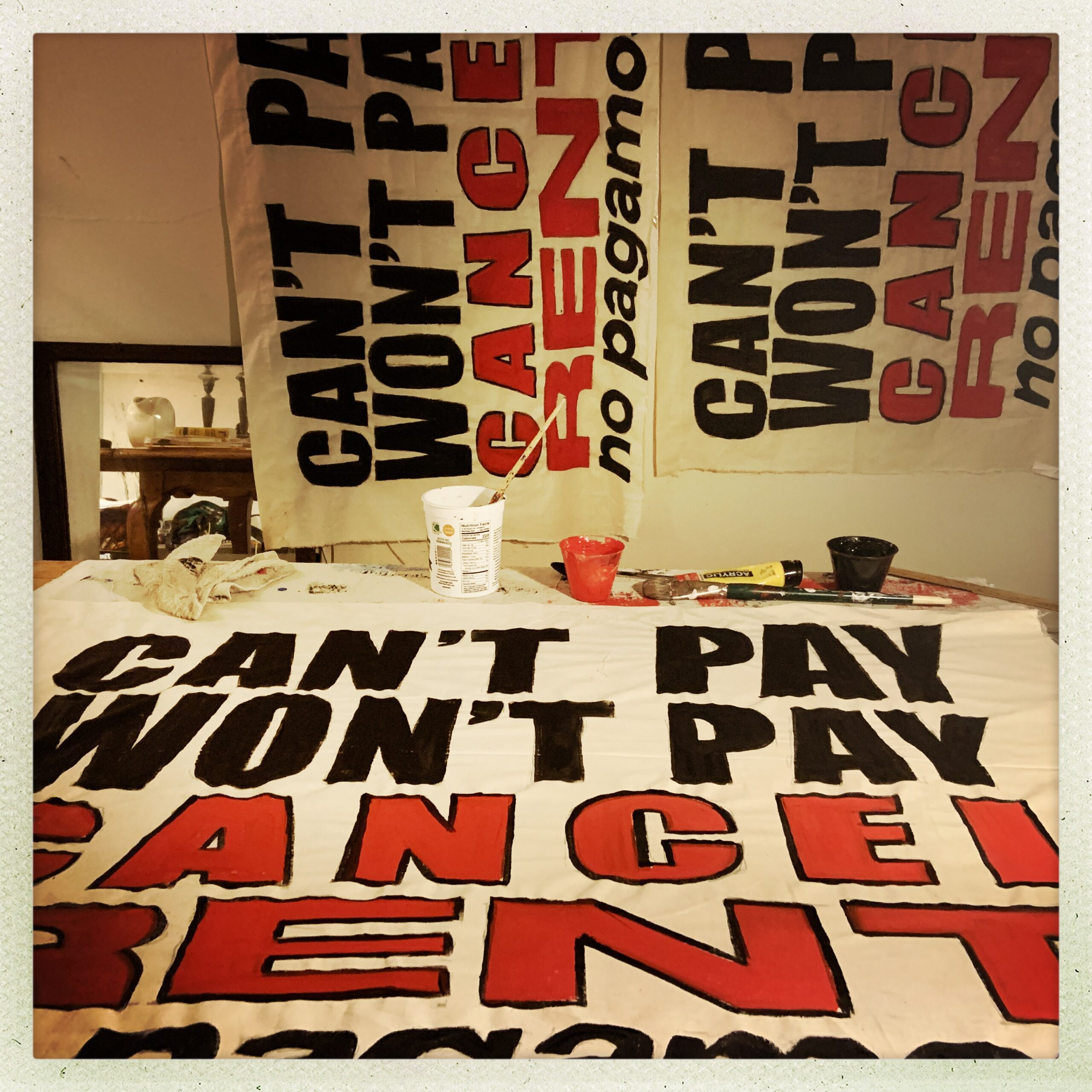 """The Stop Shopping Choir banner: """"Can't Pay Won't Pay Canel Rent"""""""