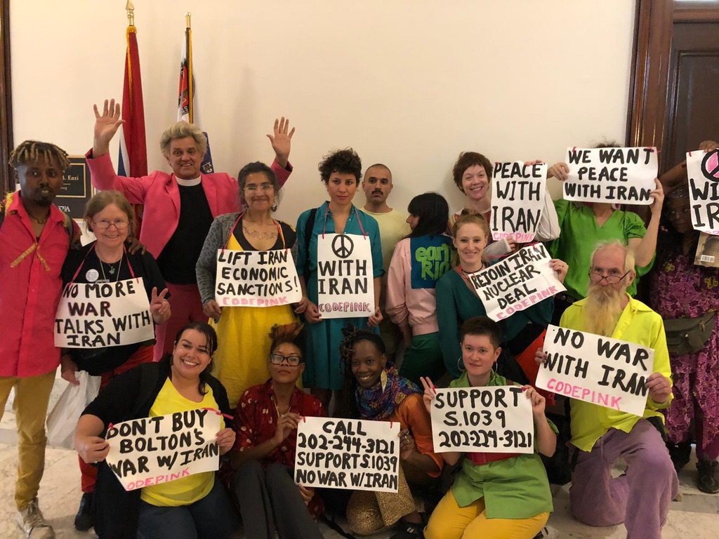 Reverend Billy and the Stop Shopping Choir peace with Iran action