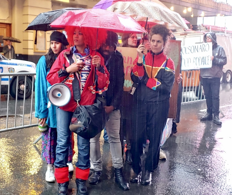 Savitri D and The Stop Shopping Choir in the rain